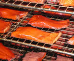 Fillets of salmon in hot smoker.